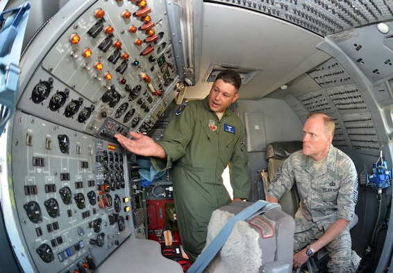 Staff Sgt. Mike Hamm, left, explains to Chief Master Sgt. of the Air Force James A. Cody the role of controls within an E-8 JSTARS aircraft June 25, 2014, on Robins Air Force Base, Ga. Cody met with more than 2,000 Airmen while visiting Robins AFB June 24-25. Hamm is with the 116th Air Control Wing. (U.S. Air Force photo/Staff Sgt. Kelly Goonan)
