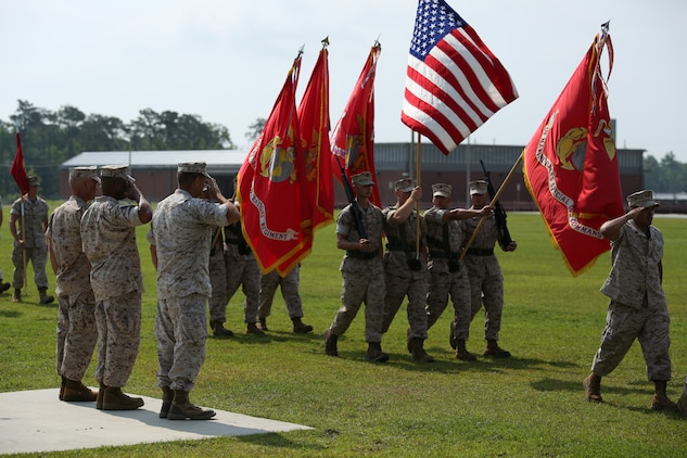 Sergeant Maj. Thomas A. Hall Jr., (left), former sergeant major of U.S. Marine Corps Forces Special Operations Command, (MARSOC), Sgt. Maj. John W. Scott (middle), sergeant major of MARSOC, and Maj. Gen. Mark A. Clark (right), commander of MARSOC, salute the national ensign during a relief, appointment and retirement ceremony at Stone Bay, aboard Marine Corps Base Camp Lejeune, N.C., June 27.