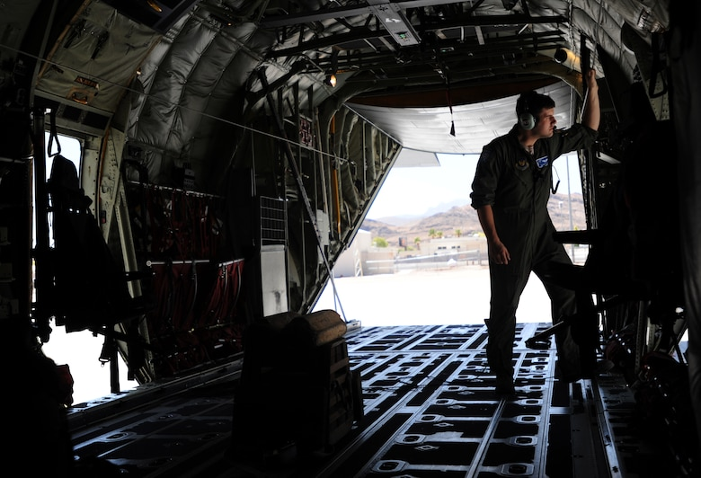 Senior Airman Spencer Smith, from the 37th Airlift Squadron, Ramstein Air Base, Germany, conducts pre-flight inspections on a C-130J Super Hercules aircraft before departing Creech Air Force Base, Nev., June 22, 2014.  Smith and other Airmen visited Creech AFB as part of Joint Forcible Entry, an exercise designed to enhance service cohesiveness between the U.S. Army and Air Force. Both services work together to properly execute large scale heavy equipment and troop movement. (U.S. Air Force photo by Senior Master Sgt. Cecilio Ricardo/Released)