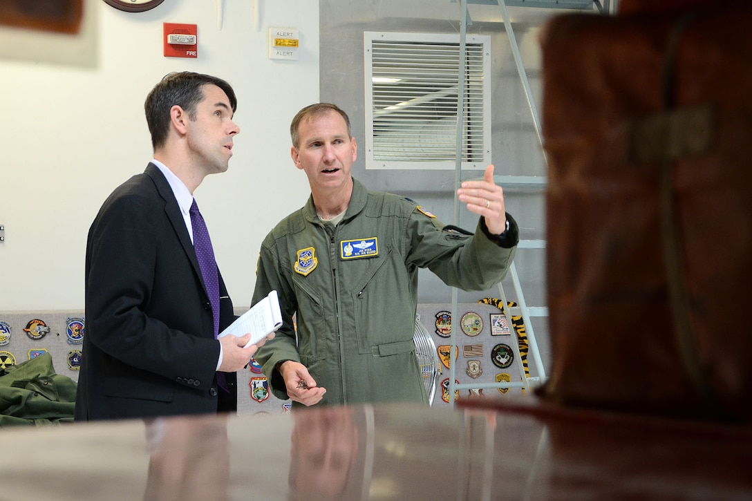 PEASE AIR NATIONAL GUARD BASE, N.H. – Lieutenant Col. James Ryan, 133rd Air Refueling Squadron commander, explains to Brad Bowman, the senior military legislative assistant for U.S. Senator Kelly Ayotte, the many features of the new 157th Operatons Group building during a visit to the base June 27. During the visit, N.H. Army National Guard Lt. Col. Roy Hunter, president of the National Guard Association of N.H., presented Bowman the General John Stark Award. Bowman was instrumental in the 157 ARW obtaining funding for the Deployment Cycle Support – Care Coordination Program and the wing's quest to receive the KC-46A refueling tanker while in his role as senior military legislative lead to the senator. (N.H. Air National Guard photo by Tech. Sgt. Mark Wyatt)
