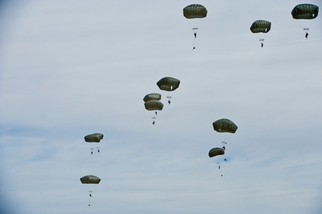 Jumpers from the U.S. Army 82nd Airborne Division, Fort Bragg, N.C., parachute out of a C-17 Globemaster during a U.S. Air Force Weapons School Joint Forcible Entry exercise June 21, 2014, over the Nevada Test and Training Range. The 82nd Airborne Division participated in the exercise for a joint integration with the U.S. Air Force to set the entry conditions for the forcible entry. (U.S. Air Force photo by Senior Airman Christopher Tam)