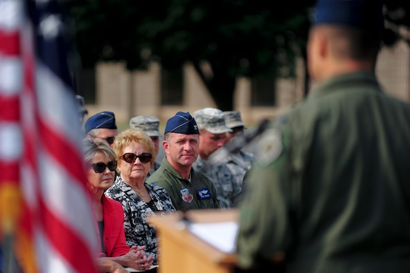 "Betty Blesse, wife of retired Maj. Gen. Frederick ""Boots"" Blesse, and Col. Mark Slocum listen to a guest speaker during a memorial dedication ceremony to honor Betty's late husband, June 27, 2014, on Seymour Johnson Air Force Base, N.C. During the Korean War, Blesse flew with the 334th Fighter-Interceptor Squadron and was credited with 10 aerial kills, making him one of 11 double aces during the conflict. Slocum is the 4th Fighter Wing commander. (U.S. Air Force photo/Airman 1st Class Brittain Crolley)"