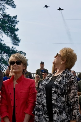 "Betty Blesse, wife of retired Maj. Gen. Frederick ""Boots"" Blesse, watches as two F-4 Phantom IIs fly overhead during a memorial dedication ceremony, June 27, 2014, on Seymour Johnson Air Force Base, N.C. Blesse flew the Phantom II during his tour in Vietnam, he had a total of 108 combat missions and 46 sorties. (U.S. Air Force photo/Airman 1st Class Aaron J. Jenne)"