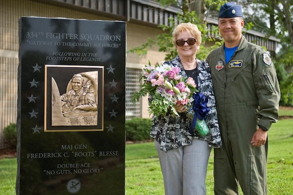 "Betty Blesse, wife of retired Maj. Gen. Frederick ""Boots"" Blesse, stands with Lt. Col. Donn Yates after the unveiling of her late husband's monument during a memorial dedication ceremony, June 27, 2014, on Seymour Johnson Air Force Base, N.C. The memorial was constructed at the front of the 334th FS, the unit Blesse was assigned to when he recorded his 10th aerial kill. Yates is the 334th Fighter Squadron commander. (U.S. Air Force photo/Airman 1st Class Aaron J. Jenne)"