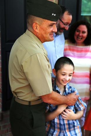 """Maj. Gen. Frederick Padilla, director of operations for Plans, Policies and Operations, Headquarters Marine Corps, celebrates with Andrew Starr after a ceremony awarding Starr the title """"honorary Marine."""" Seven-year-old Andrew, having been diagnosed with Neurofibromatosis Type 1, is only the second person to receive the title in 2014."""