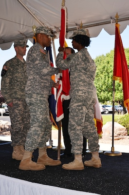 ALBUQUERQUE, N.M., -- Outgoing District Commander Lt. Col. Antoinette Gant (right) hands the Corps of Engineers flag to Brig. Gen. C. David Turner June 26, 2014, signifying the transfer of command responsibility to incoming commander Lt. Col. Patrick Dagon (left).