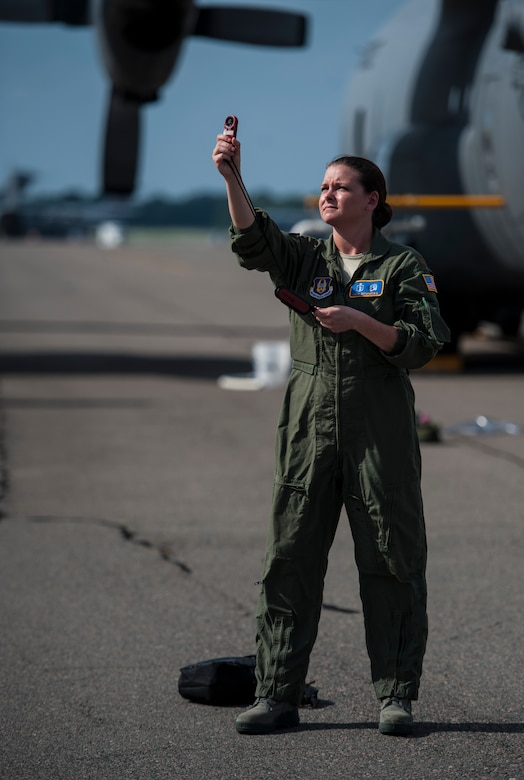 Maj. Jen Remmers, 910th Airlift Wing, Youngstown Air Reserve Station, Ohio, checks the wind speed June 25, 2014, at Joint Base Charleston, S.C. The C-130 Hercules and crew sprayed for mosquitos on JB Charleston and is the only unit of its kind in the Air Force.  (U.S. Air Force photo/Airman 1st Class Clayton Cupit)