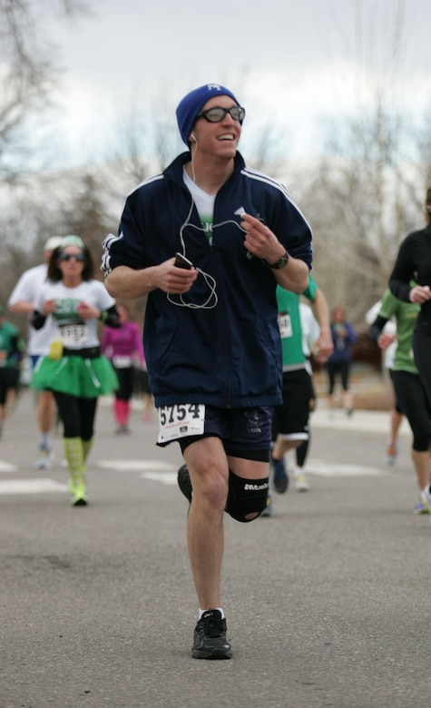 Capt. Brian Thorn, 460th Space Communication Squadron flight commander, races in the Lucky Laces 10k Run March 15, 2014, in Denver, Colo.Thorn is training to run in the Air Force Marathon as part of the Air Force Space Command team. (Courtesy photo)