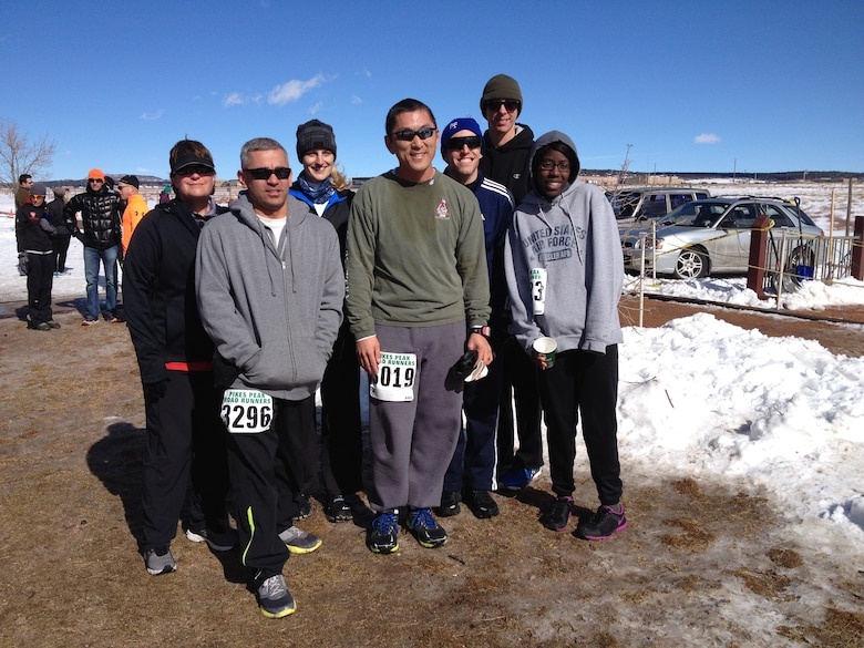 Senior Master Sgt. Tammy Gaudu, 460th Space Communication Squadron flight chief, (left) and Capt. Brian Thorn, 460th SCS flight commander, (right) pose with other Team Buckley members after completing the Pike's Peak Road Runners race Jan. 25, 2014. Gaudu and Thorn are training to run in the Air Force Marathon as part of the Air Force Space Command team. (Courtesy photo)