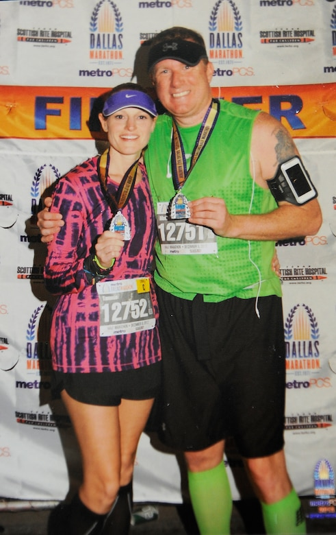 Senior Master Sgt. Tammy Gaudu, 460th Space Communication Squadron operations flight chief, poses with her husband after finishing a half-marathon in 2012. Gaudu is training to run in the Air Force Marathon as part of the Air Force Space Command team. (Courtesy photo)