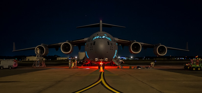 437th Airlift Wing maintainers perform routine maintenance and system checks on a C-17 Globemaster III June 25, 2014, at Joint Base Charleston, S.C. The maintainers perform checks and maintenance around the clock to ensure the aircraft are ready to fly. (U.S. Air Force photo/ Airman 1st Class Clayton Cupit)