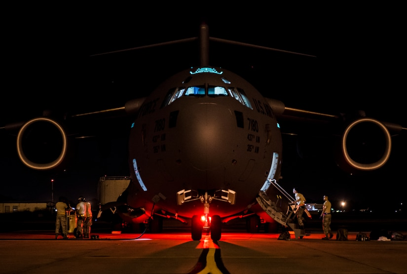 437th Airlift Wing maintainers perform routine maintenance and system checks on a C-17 Globemaster III June 25, 2014, at Joint Base Charleston, S.C. The maintainers perform checks and maintenance around the clock to ensure the aircraft are ready to fly. (U.S. Air Force photo/ Senior Airman Dennis Sloan)