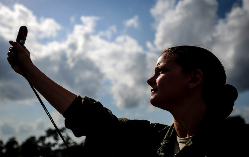 Maj. Jen Remmers, 910th Airlift Wing, Youngstown Air Reserve Station, Ohio, checks the wind speed June 25, 2014, at Joint Base Charleston, S.C. The C-130 Hercules and crew sprayed for mosquitos on JB Charleston and is the only unit of its kind in the Air Force.  (U.S. Air Force photo/Senior Airman Dennis Sloan)