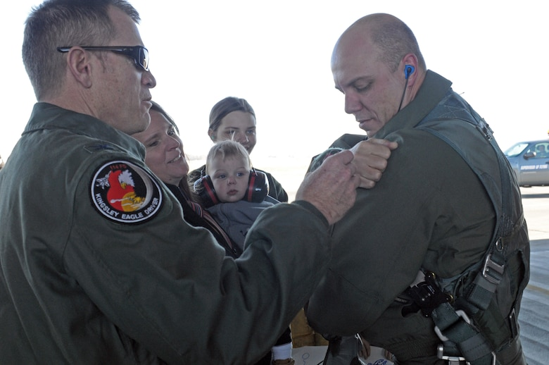 """Col. Wes """"Pappy"""" French pins Lt. Col. David """"Down"""" Unruh with a 2,000 hour patch immediately after he disembarked from an F-15 aircraft at Kingsley Field, where he crossed that threshold. (U.S. Air National Guard photo by Master Sgt. Jennifer Shirar)"""