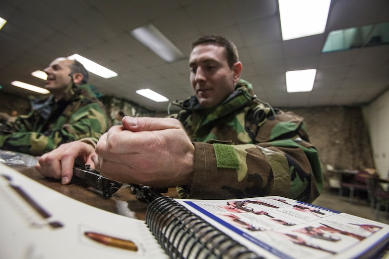 Tech. Sgt. Brandon Kehr, reassembles his Beretta M9 pistol as airmen from the 108th Wing, New Jersey Air National Guard, brush up on their chemical, biological, radiological and nuclear; self-aid buddy care; post attack reconnaissance and disassembling and reassembling Beretta M9 pistol and M16 rifle skills during the Wing's Ability to Survive and Operate Rodeo at Joint Base McGuire-Dix-Lakehurst, N.J. Feb. 9, 2014. The Wing-level evaluation shows what training areas need more focus. ATSO is used by airmen who are deploying or preparing for exercises or inspections. These skills make up the foundation necessary for all airmen to function effectively in hostile environments. (U.S. Air National Guard photo by Master Sgt. Mark C. Olsen/Released)