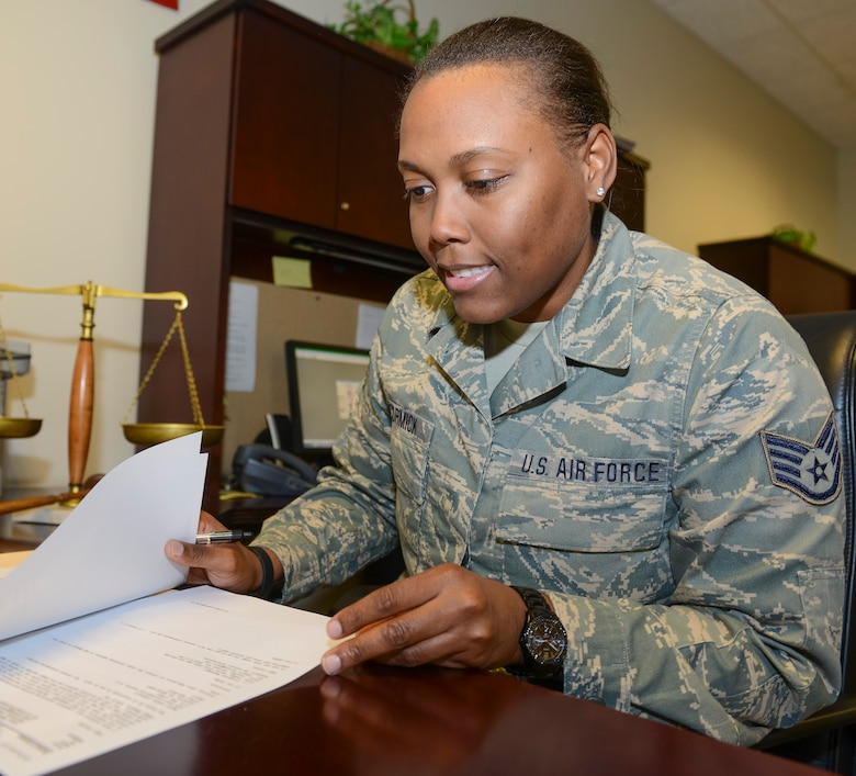 Air Force Staff Sgt. Barricia McCormick, a paralegal with the 116th Air Control Wing, Georgia Air National Guard, reviews legal cases during a drill weekend at Robins Air Force Base, Ga., Feb. 8, 2014. McCormick, who comes from a long line of family members who have served in the armed forces dating back to World War I, is related to Harriet Ross Tubman, the African-American abolitionist and humanitarian responsible for the rescue of more than 300 slaves through the Underground Railroad. (Georgia Air National Guard photo by Air Force Master Sgt. Roger Parsons)