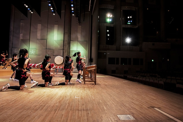 Participants of the 2014 U.S.-Japan Friendship Concert perform on taiko drums and other instruments during the concert that took place inside the Iwakuni Sinfonia Feb. 15. Several schools from out in Iwakuni and Matthew C. Perry Schools attended the event.