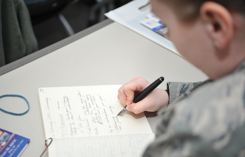 Staff Sgt. Cassandra Lane, 51st Civil Engineer Squadron emergency management journeyman, takes notes during the Military Saves Week thrift savings plan and retirement class in the Airman and Family Readiness Center classroom at Osan Air Base, Republic of Korea, Feb. 26, 2014. Lane attended the class to learn about TSP Roth Individual Retirement Account options that might compliment her current retirement investments. (U.S. Air Force photo/Airman 1st Class Ashley J. Thum)