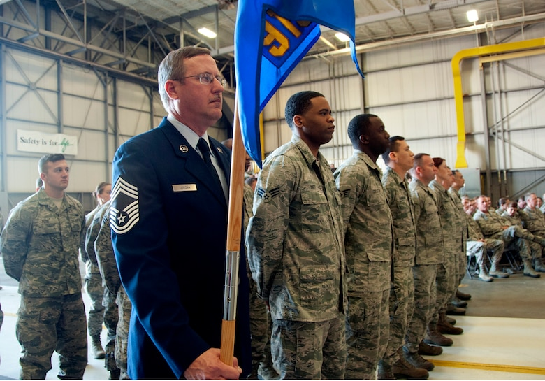 Chief Master Sgt. Leonard Jordan holds the guidon for the 919th Special Operations Mission Support Group formation during the assumption of command ceremony for Lt. Col. Brian Stahl March 1, at Duke Field, Fla. (U.S. Air Force photo/ Tech. Sgt. Cheryl Foster)
