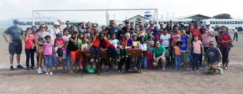 "Joint Task Force-Bravo's Medical Element (MEDEL) hosted a ""Fiesta Day"" for 40 boys, 72 girls, and 23 adult chaperones from the Hogar de Ninos and Ninas Nazareth orphanage at Soto Cano Air Base, Honduras, Mar 1, 2014.  The ""Fiesta Day"" was a way for the current MEDEL to say farewell to the children they have been supporting as their nine-month tour at Soto Cano draws to a close.  (Photo by U.S. Army Sgt. Courtney Kreft)"