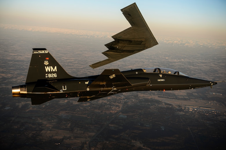 A T-38 Talon flies in formation with the B-2 Spirit of South Carolina during a training mission over Whiteman Air Force Base, Mo., Feb. 20, 2014. The B-2 Spirit is a multirole bomber capable of delivering both conventional and nuclear munitions. (U.S. Air Force photo/Staff Sgt. Jonathan Snyder)