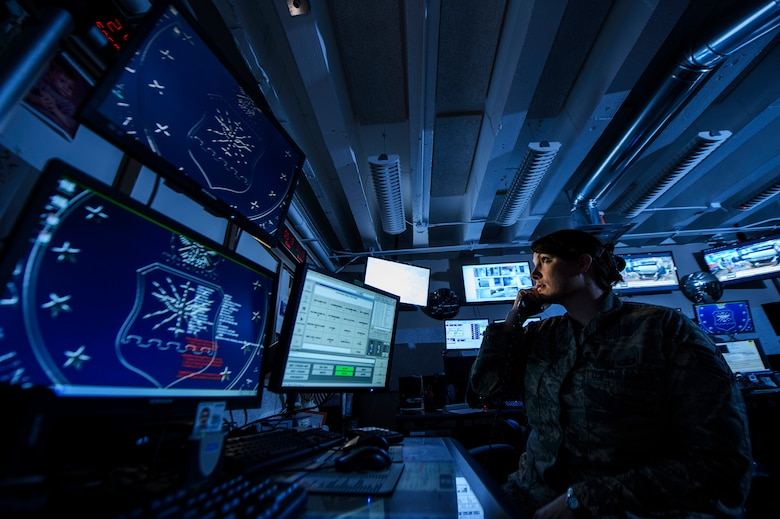 Tech. Sgt. Amber Perry monitors base activities to help facilitate the wing's mission at Barksdale Air Force Base, La., Feb. 24, 2014. Perry is a 2nd Bomb Wing command post controller. (U.S. Air Force photo/Staff Sgt. Jonathan Snyder)