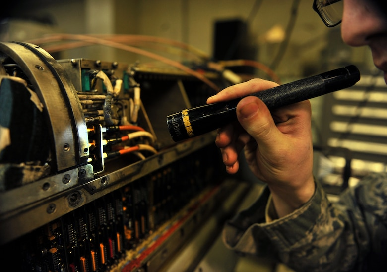 Senior Airman Timothy Pack, 51st Maintenance Squadron electronic warfare technician, inspects a component on an AN/ALQ-184 electronic countermeasure pod at Osan Air Base, Republic of Korea, Feb. 28, 2014. Electronic warfare techs guarantee the safety of Osan's aircraft fleet by providing total structural and electronic maintenance and repairs to the AN/ALQ-184 ECM pod. (U.S. Air Force photo/Senior Airman Siuta B. Ika)