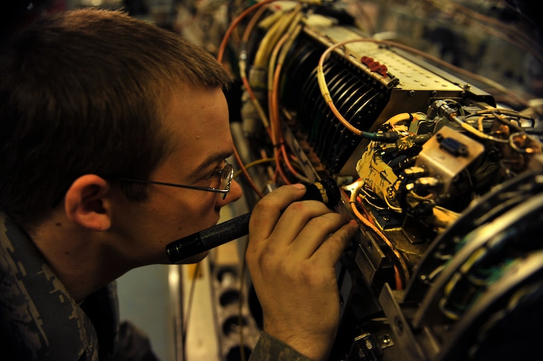 Senior Airman Jonathon Buck, 51st Maintenance Squadron electronic warfare technician, inspects a component on an AN/ALQ-184 electronic countermeasure pod at Osan Air Base, Republic of Korea, Feb. 28, 2014. Electronic warfare techs guarantee the safety of Osan's aircraft fleet by providing total structural and electronic maintenance and repairs to the AN/ALQ-184 ECM pod. (U.S. Air Force photo/Senior Airman Siuta B. Ika)