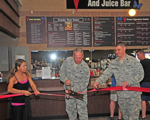 U.S. Air Force Col. Greg Williams, 355th Mission Support Group commander, cuts the ribbon to signify the official opening of the juice bar at the Benko Fitness Center on Davis-Monthan Air Force Base, March 3, 2014. The juice bar is hoping to provide a healthy lifestyle to Airmen while they work to stay fit. (U.S. Photo by Senior Airman Josh Slavin/Released)