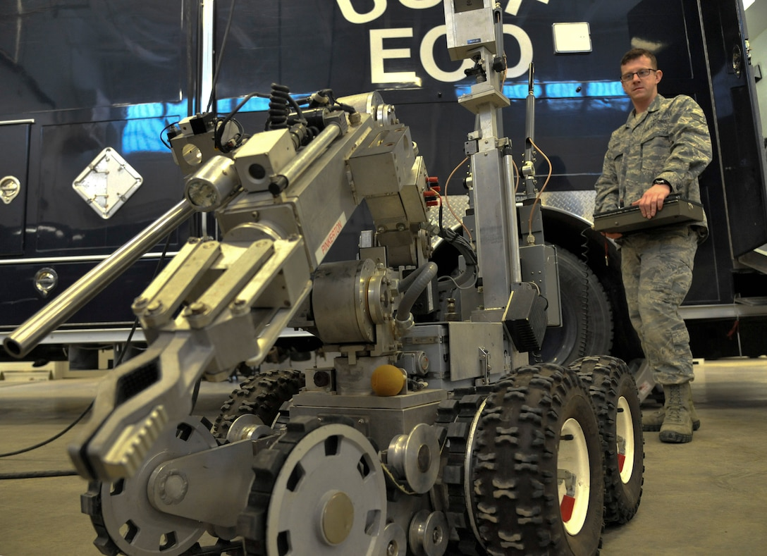U.S. Air Force Staff Sgt. Donald Ross, 509th Civil Engineer Squadron explosive ordnance disposal team member, operates an F6A robot at Whiteman Air Force Base, Mo., Feb. 11, 2014. This robot is capable of moving certain pieces of ordnance, depending on weight, to safer locations. They place charges on improvised explosive device and detonate them from a distance. (U.S. Air Force photo by Airman 1st Class Keenan Berry/Released)