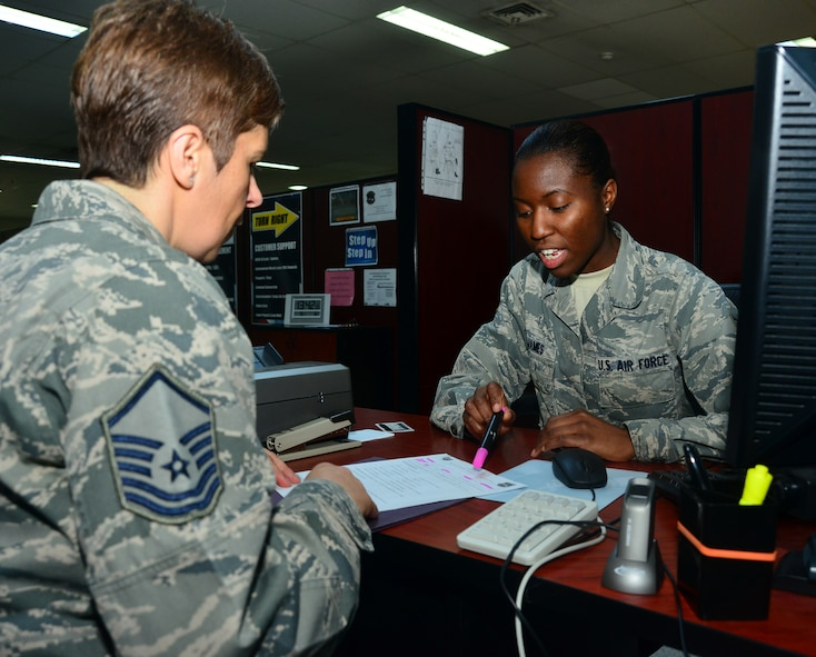 Senior Airman Juanita James, 39 Force Support Squadron personnelist, reviews the in-processing checklist with a customer who recently arrived to the 39th Air Base Wing, March 3, 2014, at Incirlik Air Base, Turkey. The checklist is part of new streamlined process that helps members expeditiously in-process at Incirlik AB. (U.S. Air Force photo by Staff Sgt. Eric Summers Jr./Released)