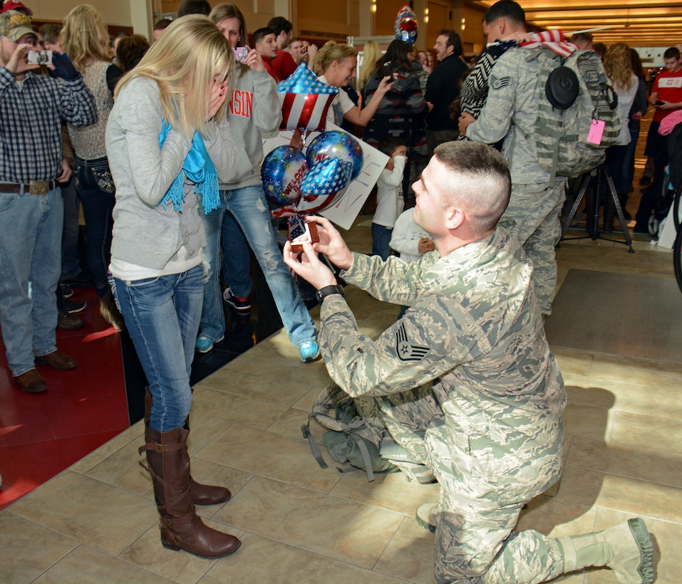 Staff Sgt. Justin Padley, fire team member for the Wis. Air National Guard's 115th Fighter Wing Security Forces Squadron proposes to his soon-to-be fiancée Wendy Anderson upon returning to Dane County Regional Airport  Mar. 2. Twenty six members of the Wing's Security Forces Squadron spent six months deployed in support of Operation Enduring Freedom/Combined Joint Task Force-Horn of Africa and secured 3,500 personnel and $7.2 billion worth of assets within their area of responsibility. (Air National Guard photo by Master Sgt. Paul Gorman)