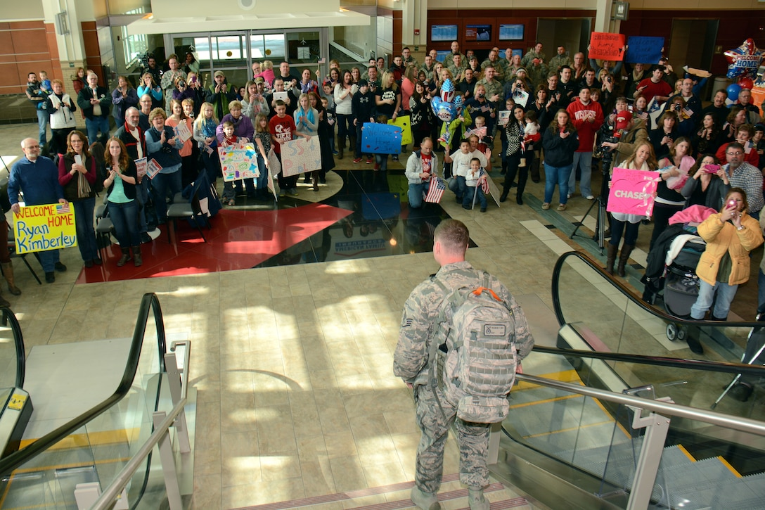 Family and friends alike applaud as Security Forces personnel from the Wisconsin Air National Guard's 115th Fighter Wing return to Dane County Regional Airport March 2, where they are reunited with loved ones for the first time in over six months. Twenty six members of the Wing's Security Forces Squadron deployed in support of Operation Enduring Freedom/Combined Joint Task Force-Horn of Africa and secured 3,500 personnel and $7.2 billion worth of assets within their area of responsibility. (Air National Guard photo by Master Sgt. Paul Gorman)