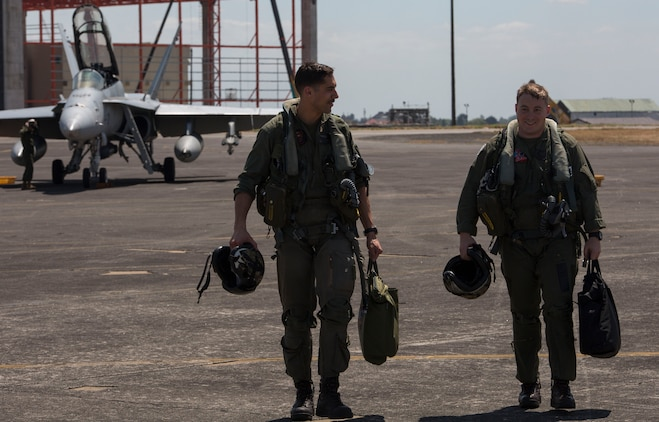 Maj. Norman Mitchell, left, a pilot, and Capt. William Barrett, right, a weapon systems officer with Marine All-Weather Fighter Attack Squadron 224, walk back to their hangar after a successful flight during Exercise Haribon Tempest 2014 aboard Clark Air Base, Republic of the Philippines, Feb. 20. HT 14 is a small-scale bilateral exercise between the United States Marine Corps and the Philippine Air Force. The exercise provides training in close-air support, section engaged maneuvering training and combined combat capabilities.