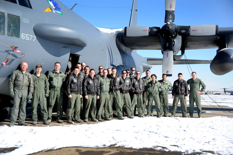 Members of the 16th Special Operations Squadron stand alongside their prized AC-130H Spectre gunship Feb. 2, 2014 at Cannon Air Force Base, N.M. As this aircraft is sent into retirement, the sensor operators bid farewell to an aerial asset that has not only served its country proud, but leaves a lasting American Legacy to future generations. (U.S. Air Force Photo/Airman 1st Class Chip Slack)