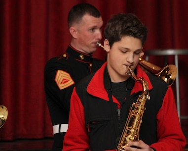 SYOSSET, N.Y. - A. J. Belloco, a music student at Syosset High School, plays with the Marine Corps Jazz Ensemble on March 3 at Syosset High School.  The Marine Corps Jazz Ensemble is performing at several high schools and universities in the Greater New York City and Boston areas with exceptional music programs to promote the Corps' Musician Enlistment Option Program.  (U.S. Marine Corps photo by Lance Cpl. Brandon Thomas).