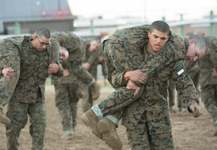 Rct. Julian Morris carries Rct. Jacob Ligon, both with Platoon 2028, Golf Company, 2nd Recruit Training Battalion, during a martial arts endurance course Feb. 6, 2014, on Parris Island, S.C. The course consists of different stations at which recruits practice martial arts techniques they learned earlier in training to increase their proficiency, strength and stamina. The course is part of the Marine Corps Martial Arts Program, which combines hand-to-hand combat skills with mental discipline and character development to help transform recruits into honorable warriors. Morris, a 20-year-old native of Dover, N.J., and Ligon, a 19-year-old native of Monroe, La., are scheduled to graduate April 11, 2014. Parris Island has been the site of Marine Corps recruit training since Nov. 1, 1915. Today, approximately 20,000 recruits come to Parris Island annually for the chance to become United States Marines by enduring 13 weeks of rigorous, transformative training. Parris Island is home to entry-level enlisted training for 50 percent of males and 100 percent of females in the Marine Corps. (Photo by Lance Cpl. Vaniah Temple)
