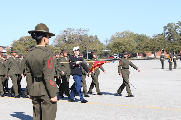 U.S. Marine Corps Pfc. Callahan Brown marches in front of her platoon as the Company Honor Graduate from Platoon 4007, Papa Co., 4th Recruit Training Battalion, who graduated Feb. 28, 2014.  She was recruited out of Recruiting Station Frederick by Staff Sgt. Craig Taylor. (U.S. Marine Corps photo by Cpl. Nicholas S. Ranum/Released)