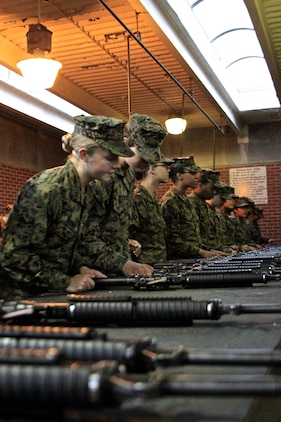 U.S. Marine Corps Pfc. Callahan Brown performs one last inspection of her rifle before she turns it in at the armory aboard Marine Corps Recruit Depot Parris Island, S.C. She is the Company Honor Graduate from Platoon 4007,Papa Co., 4th Recruit Training Battalion, graduated Feb. 28, 2014. She was recruited for Recruiting Station Frederick by Staff Sgt. Craig Taylor out of Springfield, Va. (U.S. Marine Corps photo by Sgt. Amber Williams/Released)