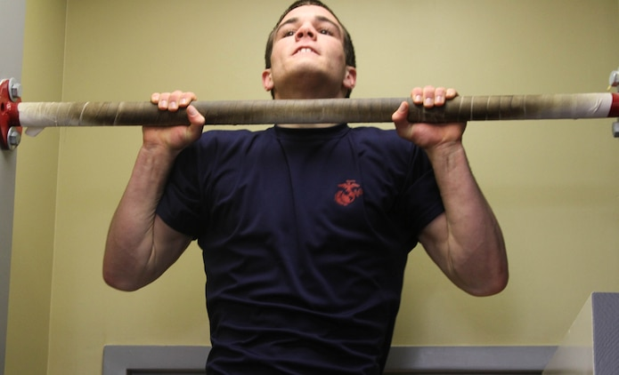 Chris Jaeger, a poolee with Marine Corps Recruiting Station Raleigh, does pull-ups during an initial strength test at Permanent Contact Station Sanford in Sanford, N.C., Feb. 27, 2014. Jaeger, a senior from Chatham Central High School in Bear Creek, N.C., won the North Carolina 1A Wrestling State Championship in the 138-pound weight class. (U.S. Marine Corps photo by Sgt. Dwight A. Henderson/Released)