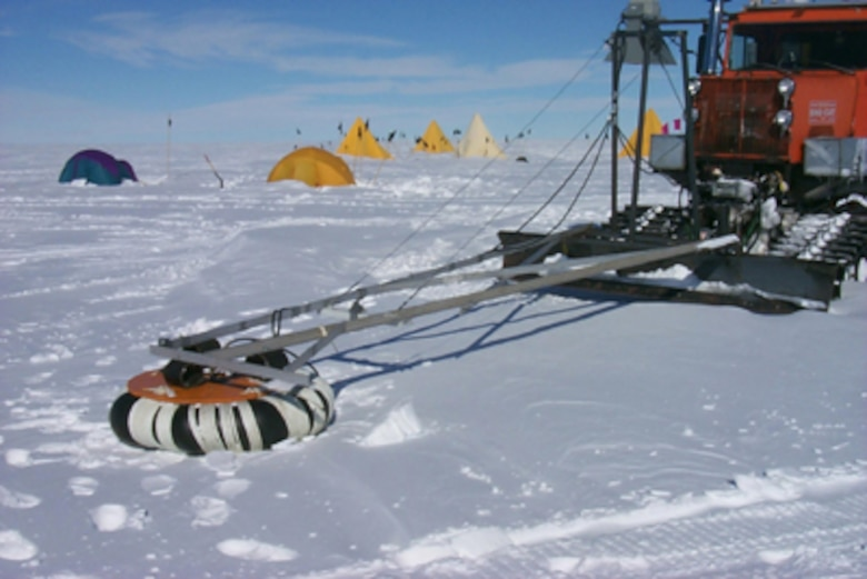 "An inner tube is positioned from an arm extended from the front of a snow tractor, within the tube is an antenna that is looking down into the snow/ice layer and transmitting information to monitors.    According to CRREL Research Geophysicist Dr. Steve Arcone, ""GPR is a radio method to image snow and ice stratigraphy.  The system is operated by pushing the antennas in front of a small tractor, while the operator monitors the imaged strata on a computer screen.  Crevasses are detected in advance by viewing reflections from the vertical crevasse walls."""