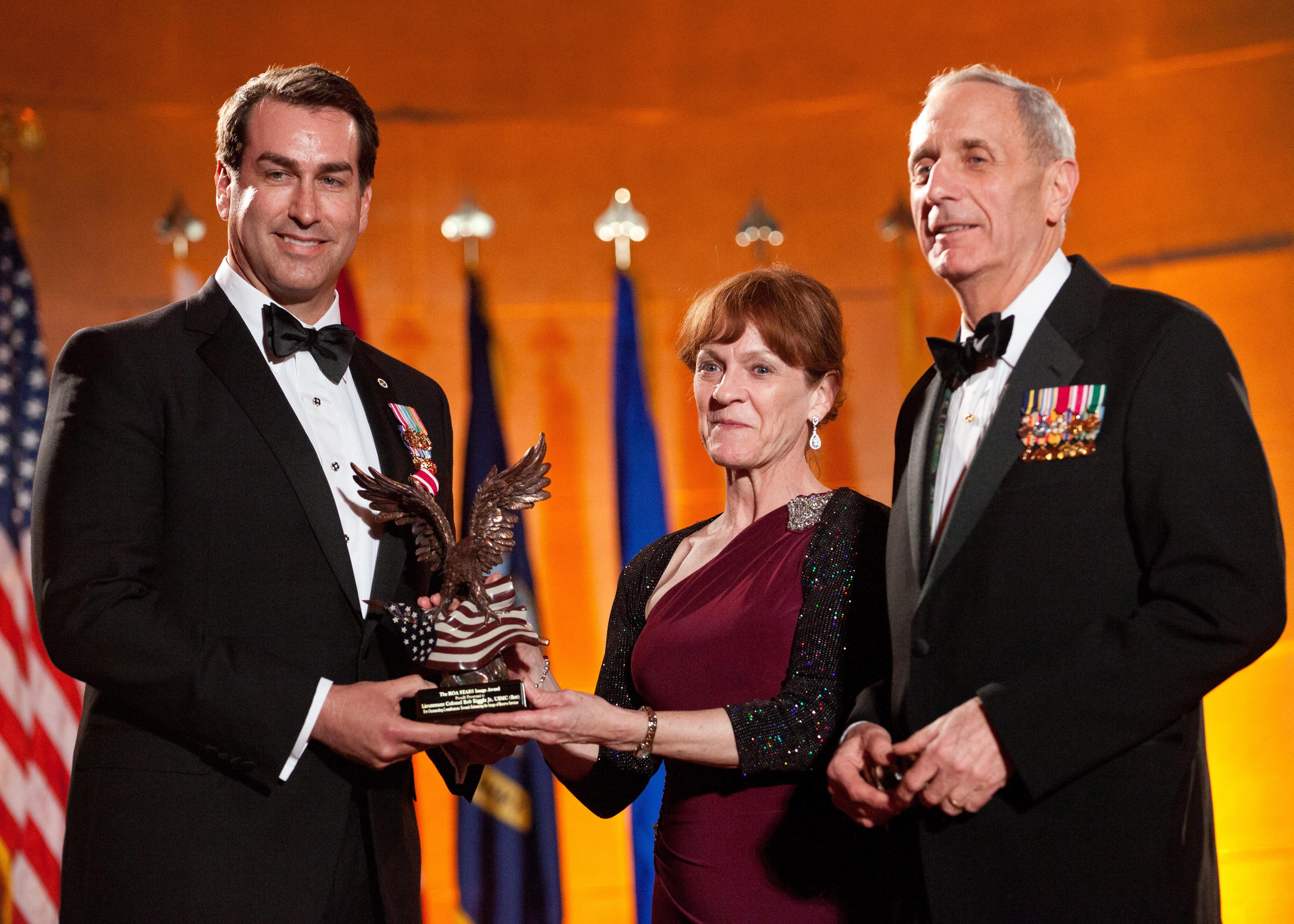 U.S. Marine Corps Retired Lt. Col. Robert Riggle, Jr., Left,