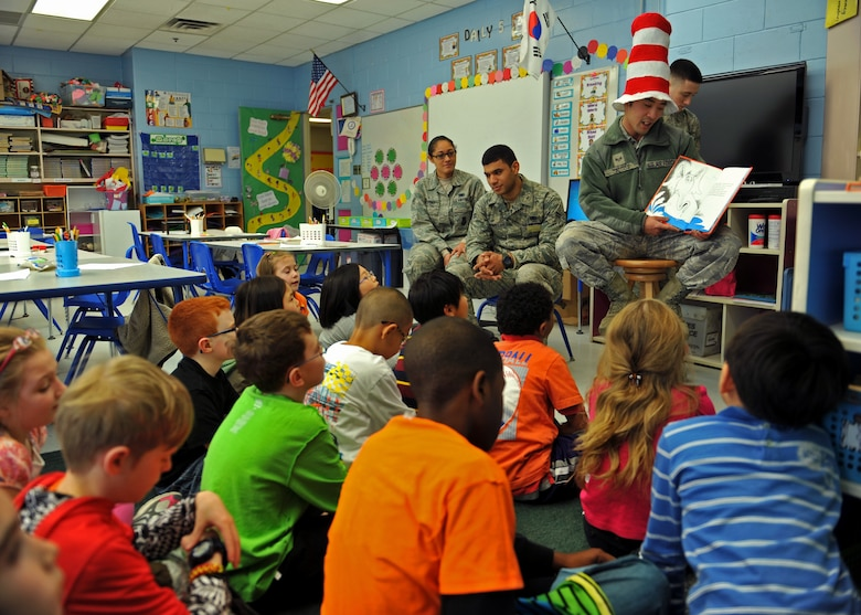 Senior Airman Hong Dick Li, a member of the 51st Security Forces Squadron, reads a book to third-grade students during Read Across America Day in celebration of Dr. Seuss' Birthday at Osan Air Base, Republic of Korea, March 5, 2014. Li and other Airmen read to multiple Osan American Elementary School students in kindergarten through fifth grade. (U.S. Air Force photo/Senior Airman Siuta B. Ika)