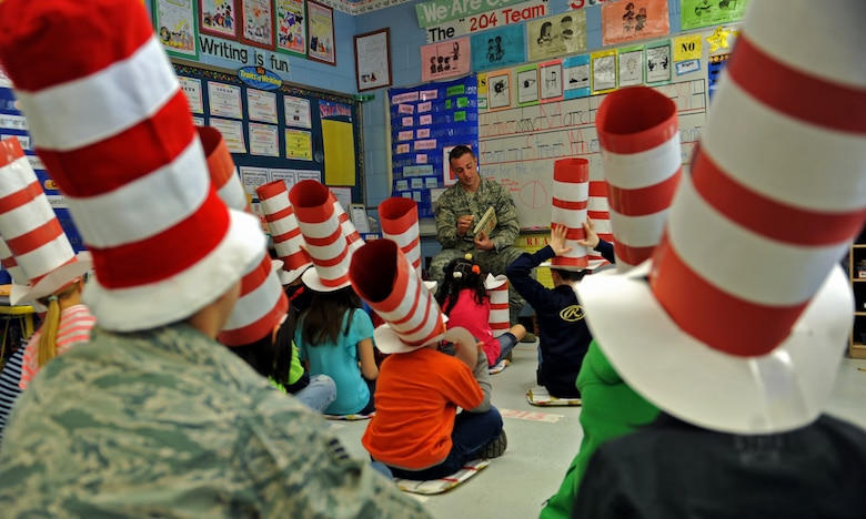 Staff Sgt. Charles Cornacchio, a member of the 51st Security Forces Squadron, reads a book to third-grade students during Read Across America Day in celebration of Dr. Seuss' Birthday at Osan Air Base, Republic of Korea, March 5, 2014. More than 50 Team Osan military members volunteered to read to 21 Osan American Elementary School classes. (U.S. Air Force photo/Senior Airman Siuta B. Ika)