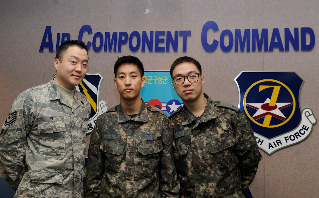 U.S. Air Force Tech Sgt. Isaac Yi and Republic of Korea Air Force 2nd Lts. Yohan Kim and Wero Jung with the 7th Air Force Air Component Command Plans and Coordination Division, serve as linguists during Exercise Key Resolve 2014 at Osan Air Base, Republic of Korea, March 6, 2014.  Linguists translate and transcribe key messages between the Republic of Korea and U.S. Air Force. (U.S. Air Force photo/Airman 1st Class Omari Bernard)