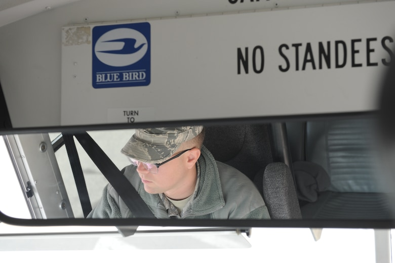 Airman 1st Class Sean Humphrey, a vehicle operator with the 18th Logistics Readiness Squadron at Kadena Air Force Base, Japan, drives U.S. Armed Forces to and from their destinations at Osan Air Base, Republic of Korea, Feb. 26, 2014. Airmen with the 18 LRS transport augmentees in support of Exercise Key Resolve 2014. (U.S. Air Force Photo/Airman 1st Class Omari Bernard)