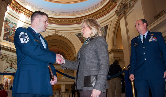 Senior Master Sgt. Kenneth Toon, left 507th Air Refueling Wing recruiting flight chief greets Gov. Mary Fallin at the Oklahoma State Capital, March 5 along with Col. Thomas Smith, 507th Operations Group commander, right.   Some of the 507th Air Refueling Wing's newest Air Force Reserve recruiters met with the Oklahoma governor to thank her for her support to their recruiting efforts in the greater Oklahoma area.  (U.S. Air Force Photo/Maj. Jon Quinlan)