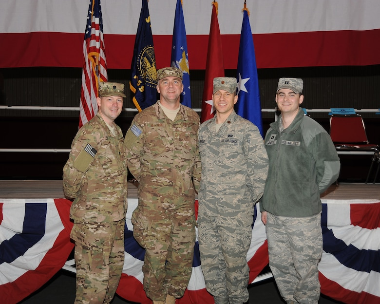 Members of the 142nd Civil Engineer Squadron leadership pose for a group picture following the mobilization ceremony held and the Portland Air National Guard Base, Ore., March 1. From left to right; Lt Col. Jason Lay, Chief Master Sgt. John McIlvain, Maj. Jacob Skugrud, and Capt. Luke Smith. (Air National Guard photo by Master Sgt. Shelly Davison, 142nd Fighter Wing Public Affairs/Released)
