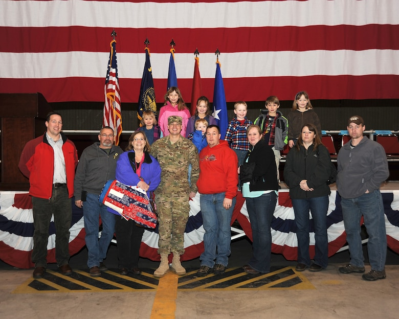 Staff Sgt. Tyler Wilson is surrounded by his family and friends following the mobilization ceremony held at the Portland Air National Guard Base, Ore., March 1. (Air National Guard photo by Master Sgt. Shelly Davison, 142nd Fighter Wing Public Affairs/Released)
