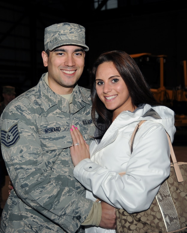 Tech. Sgt. Nicholas Menard poses with his fiancée following the mobilization ceremony held at the Portland Air National Guard Base, Ore., March 1. (Air National Guard photo by Master Sgt. Shelly Davison, 142nd Fighter Wing Public Affairs/Released)